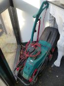 A BOSCH ELECTRIC LAWN MOWER AND STRIMMER.