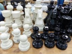 AN IMPRESSIVE OVER SIZED COMPLETE POTTERY GARDEN CHESS SET.