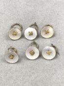 A SET OF SIX 9ct GOLD AND MOTHER OF PEARL SUIT BUTTONS. GROSS WEIGHT 10.1grms.