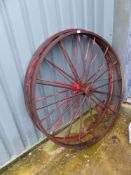 A PAIR OF VINTAGE CAST IRON WAGON WHEELS.