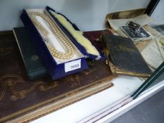 ALBUMS OF POST AND CIGARETTE CARDS, A SCRAP BOOK, LAND SALE BROCHURES AND EPHEMERA.