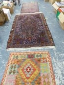 TWO EASTERN PATTERN RUGS, AND A FLAT WEAVE SMALL RUG.