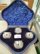 A CASED SET OF FOUR HALLMARKED SILVER SALTS.