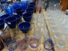 TEN VARIOUS BLUE GLAZED POTTERY GOBLETS, A QUANTITY OF DRINKING GLASS WARES, ETC.