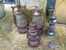FOUR VINTAGE TILLY LAMPS.
