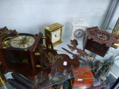 A DUTCH STYLE WALL CLOCK, A CUCKOO CLOCK, AND FOUR MANTLE CLOCKS.