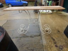A CONSOLE TABLE WITH PAINTED WROUGHT IRON BASE.