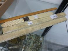 TWO ELLIOTT BONE RULERS, ANOTHER BAMBOO RULER TOGETHER WITH A PAPER KNIFE.