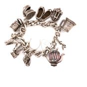 A HALLMARKED SILVER VINTAGE CHARM BRACELET, COMPLETE WITH AN ASSORTMENT OF SILVER CHARMS, AN