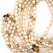 A CULTURED PEARL AND 14ct GOLD MULTI STRAND NECKLACE. THE FOUR ROWS OF OVAL PEARLS INTERSPERSED WITH