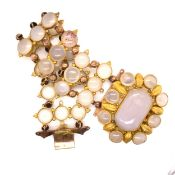 AN ANTIQUE CHALCEDONY BRACELET. THE THREE PANEL LINKS OF CABOCHON STONES JOINED BY BEADED LINKS,