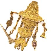 AN ANTIQUE GEORGIAN (LATE 18th / EARLY 19th C.) GILT METAL HEAVILY ENGRAVED CHATELAINE. THE BELT