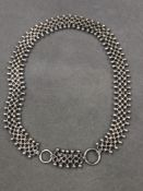 A VICTORIAN STERLING SILVER BOOK STYLE CHAIN WITH CANNONBALL DOUBLE EDGES AND TWO LARGE BOLT RING