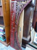A CHINESE PIERCED AND CARVED RED LACQUER GROUND ARCH