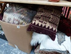 A COLLECTION OF VARIOUS FURNISHING CUSHIONS, INC. FUR AND CARPET EXAMPLES.