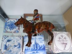 A SMALL COLD PAINTED BRONZE HORSE AND JOCKEY.
