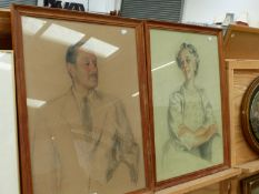 MID 20TH CENTURY ENGLISH SCHOOL. A PAIR OF PASTEL PORTRAIT STUDIES INDISTINCTLY SIGNED AND DATED E