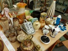 A SUSIE COOPER COFFEE SET, THREE TABLE LAMPS, ART DECO ORNAMENTS, BESWICK LION, TERRIER, AFGHAN