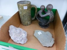 A CARVED SOAPSTONE MUG, A SMALL SOAPSTONE SCULPTURE, AND TWO FOSSIL INCLUDED STONES.