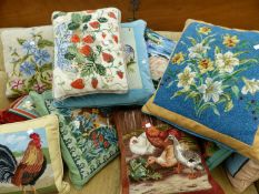 A GOOD COLLECTION OF HAND EMBROIDERED DECORATIVE CUSHIONS.