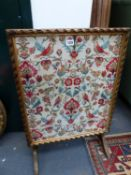 AN EMBROIDERED PANEL FOLDING SCREEN / TABLE.
