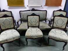 A VICTORIAN EBONISED SHOW FRAME SUITE OF THE SETTEE AND FIVE VARIOUS CHAIRS