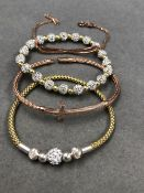 FOUR VARIOUS STERLING SILVER, ROSE AND YELLOW GILDED BRACELETS, TWO STONE SET EXPANDING EXAMPLES,