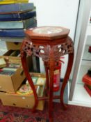 A CHINESE MARBLE INSET HARDWOOD STAND. H 92cms.