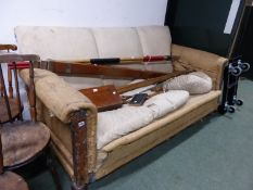 A THREE SEAT SETTEE IN NEED OF UPHOLSTERY