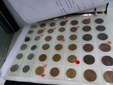 AN ALBUM OF ASSORTED COINS.