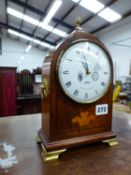 A COMITTI OF LONDON INLAID MANTLE CLOCK WITH BRASS FEET.