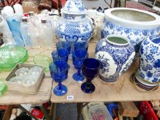 A LARGE BLUE AND WHITE FISH BOWL, TWO LAMPS, A VASE, AND VARIOUS GLASS WARE.