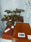 A SET OF POSTAL SCALES WITH BELL WEIGHTS, OTHER SCALE WEIGHTS ETC.