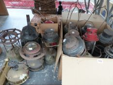 A QUANTITY OF TILLY LAMPS, VINTAGE STOVES, AND A RAILWAY LANTERN.