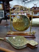 A BRASS TABLE GONG AND A SET OF BELLOWS.
