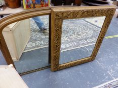 A VICTORIAN GILT FRAMED OVAL MANTLE MIRROR AND A FURTHER CARVED GILT WOOD FRAME WITH INSET MIRROR.