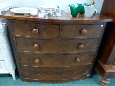 A MAHOGANY BOW FRONT CHEST OF TWO SHORT AND THREE LONG DRAWERS. W 122 x D 51 x H 99cms.