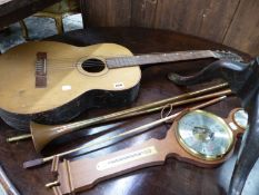 A VINTAGE GUITAR, A BAROMETER, A RIDING CROP AND TWO COACHING HORNS.