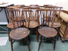 A SET OF EIGHT STICK BACK CHAIRS WITH ROUND OAK SEATS