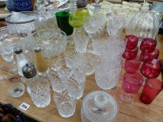 A QUANTITY OF ANTIQUE AND LATER CUT GLASS WARES.