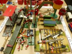 A COLLECTION OF HORNBY PLATFORMS, SIGNALS, WATER TANKS, A FOOT BRIDGE AND A LEVEL CROSSING