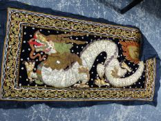A EASTERN EMBROIDERED RELIEF SEQUINNED AND BEADED PANEL OF A DRAGON.