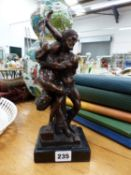 A SMALL BRONZE FIGURE, THE WRESTLERS.