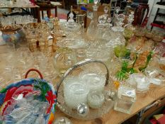 A GROUP OF NINE VARIOUS DECANTERS, DRINKING GLASSES, CUT GLASS DISHES ETC.