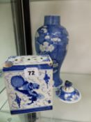 AN ORIENTAL BLUE AND WHITE BRICK VASE, AND A LIDDED VASE.