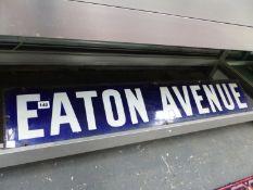 "A BLUE AND WHITE ENAMEL STREET SIGN ""EATON AVENUE"""