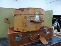 A VINTAGE LEATHER HAT BOX AND A SMALL VINTAGE LEATHER SUIT CASE.