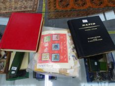 TWO ALBUMS OF WORLD STAMPS AND A QUANTITY OF LOOSE STAMPS.