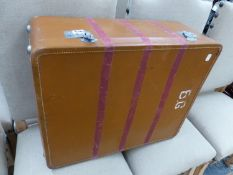 A LEATHER SUITCASE.