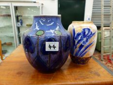 A ROYAL DOULTON ART NOUVEAU POTTERY VASE, AND A LATER VASE DECORATED WITH IRISES.